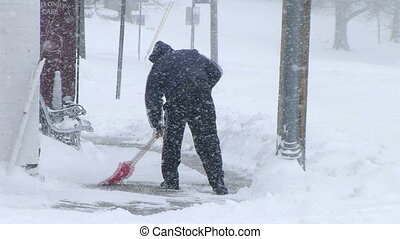Man Shoveling Snow 03 - Man shoveling snow during blizzard
