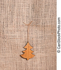 Christmas tree on burlap background