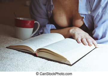 woman at home reading the book