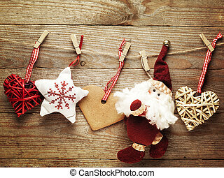 Festive Christmas decoration over wooden board background.