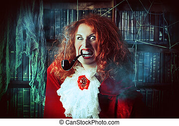 funny evil face - Portrait of a pretty funny witch in the...