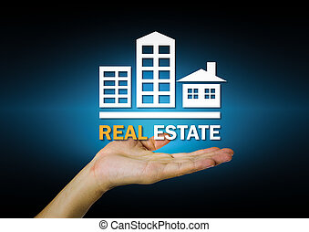 Real estate sign on hand with dark background.