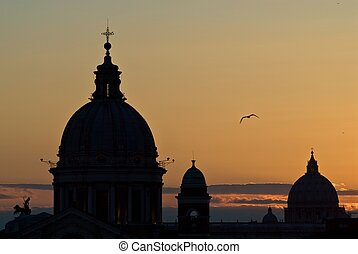 Sunset Rome skyline - Silhouette of church domes in Rome...