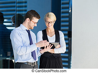 Business couple working outdoors - Two office workers having...