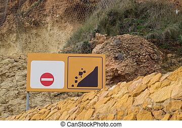 Landslide warning sign - Sign warning sign against the...