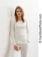 Young woman in sporty clothes - Beautiful girl in white...