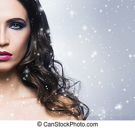 Beauty portrait of a young and gorgeous woman over snowy...