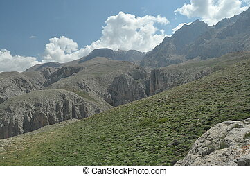 Taurus Mountains Turkey Steep cliffs and gorge Snow-capped...