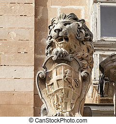 statue of lion with symbol of Mata ic capital city Valletta,...
