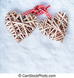 Two beautiful romantic vintage entwined beige flaxen hearts...