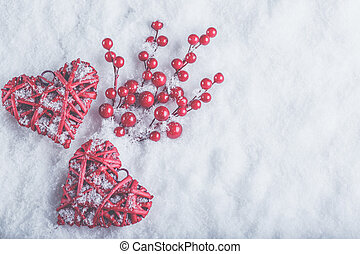 Two beautiful romantic vintage red hearts with mistletoe...