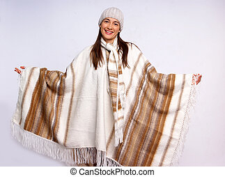 Poncho - A photo of a young girl wearing poncho.