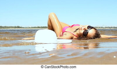 Woman with beautiful body on a tropical beach at sunny day