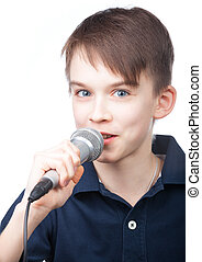 Boy with mic - Cute boy wearing blue polo speaking to...