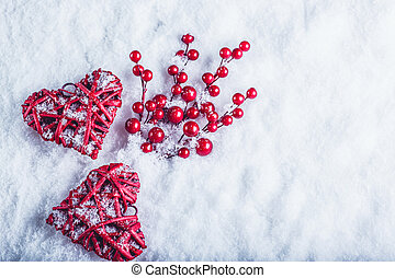Two beautiful vintage red hearts with mistletoe berries on a...