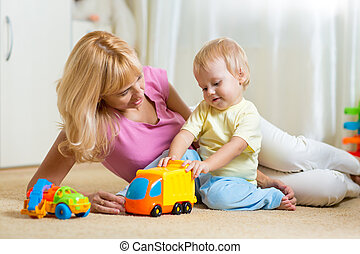 mother with child playng together at home - happy mother and...