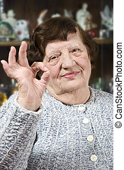 Older woman showing okay hand sign - Older woman 80s showing...