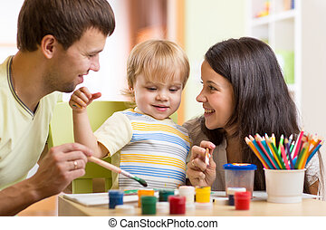 kid painting together with parents ay home - Happy kid...
