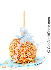 Caramel candy apple with peanuts on a stick on a white...
