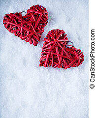Two beautiful romantic vintage red hearts together on white...
