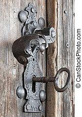 doorhandle - An old metal handle at wooden door