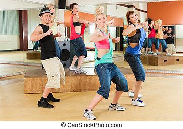 Zumba or Jazzdance - young people dancing in studio - Zumba...
