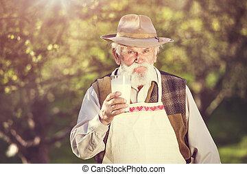 Senior man in orchard