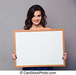 Happy woman holding blank board - Portrait of a happy woman...