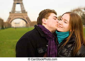 Romantic loving couple in Paris kissing near the Eiffel...