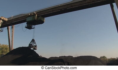 Bucket gaining coal - Coke and Chemicals plant cooler