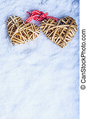 Two beautiful vintage entwined beige flaxen hearts tied...