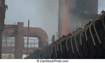 Smoke on the coke oven battery. Close-up - Coke and...