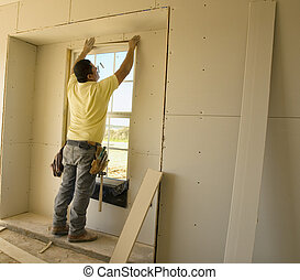 Working on the Window Sheetrock - Sheetrock worker putting...
