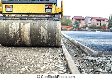 vibration roller compactor at road construction and reparing asphalt pavement. compactor working on site