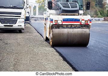 Road works, asphalting and laying fresh bitumen during...