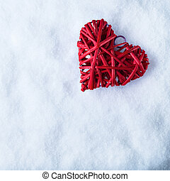 Beautiful romantic vintage red heart on a white snow winter...