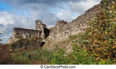 Autumn trees at the ancient destroyed fortress. Russia. -...