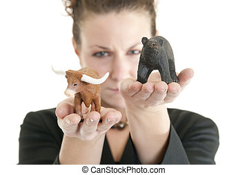 Bull market - Attractive Caucasian female holding a bull and...
