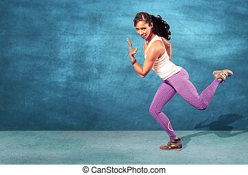 Fitness Girl - young woman at fitness exercise or zumba...
