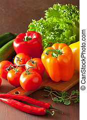 healthy vegetables pepper tomato salad on rustic background