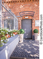 Entrance to brick building - Vertical view of entrance to...
