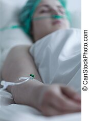 Patient resting after surgical intervention - Close up of...