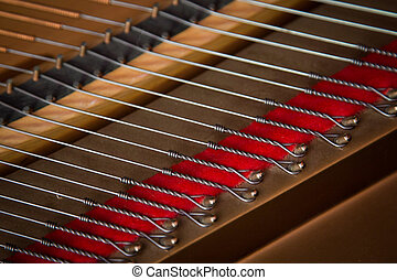Steinway baby grand piano strings - Closeup of the inside of...