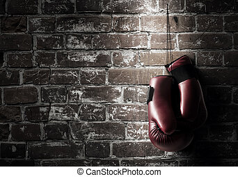 Boxing sport concept - Boxing gloves hanging nailed to wall...