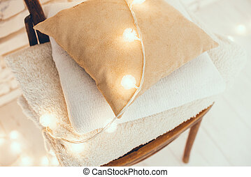 warm home decor - A stack of white and beige pillows and...