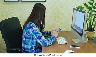 Girl in office with computer