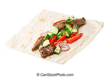Beef shawarma isolated - Beef shawarma wrap with vegetables...