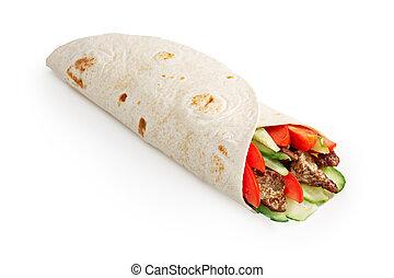 Beef shawarma isolated - Beef shawarma wrap with vegetables....
