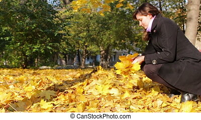 Happy Girl in the autumn park - Happy, smiling girl walking...