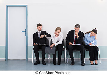 Businesspeople Waiting For Job Interview - Businesspeople...
